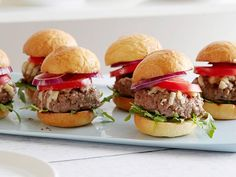 Ina gives her sliders a subtle spicy edge by mixing the ground beef with a bit of Dijon mustard. She dresses them simply, with baby arugula and some nutty Gruyere, and serves them on small Brioche buns for a classic presentation.