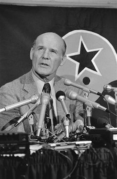 Legendary Dallas Cowboys coach Tom Landry signs a 10-year contract extension on February 5, 1964.