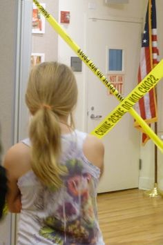 Teen library event:  Forensics/CSI demo by local police department with mock crime scene analysis.