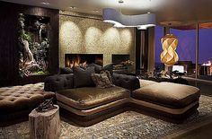 17 Bachelor Pad Decorating Ideas - Love the island of couches and pillows and the plant box on the wall.