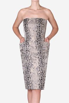 Lizard Print Strapless Dress. A stylish wardrobe is not complete without a strapless cocktail dress. Enhanced with elegant side pockets to create the prefect hourglass silhouette - keep warm with the matching Clean-Line Coat. One of Carla's favourites this season.
