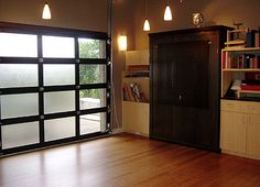 LOVE those glass garage doors. (Again I would want frosted glass)
