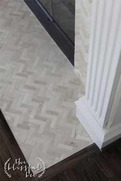 Fireplace with a Cream herringbone Stone Mosaic pattern for surround and hearth.