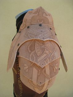 embossed leather pauldrons