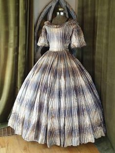 "EXC Antique Civil War Ballgown Metallic Fabric Dress  | eBay seller vintageblessings; 2 pieces button together; lined bodice w/ underarm protectors, whale boning; metallic plaid fabric, heavy w/o shredding; bust: 40""; 20"" shoulder to shoulder; skirt unlined, waist: 30""; 43.5"" length; back button closure"