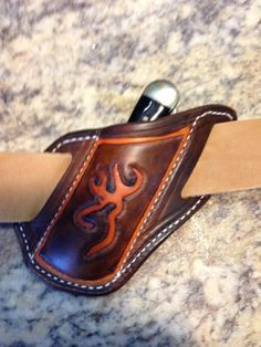 Custom hand tooled knife sheath for Trapper style or Stockman brand pocket knives 4 1/4 - 4 1/2 inches , Designed for quick draw due to the angle that it sits on the belt . made from 7-9 ounce veg tanned quality leather , lock stitched for years of dependable service , Fits belts 1