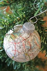 Modge podge scraps of maps over old Christmas ornaments. This would be a great idea for a Christmas tree in our office.