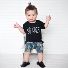This white and black so fresh tee is to cute for any little ones summer wardrobe. Love this shirt but want to add some color? Send us a message and we can do our best to make it happen!