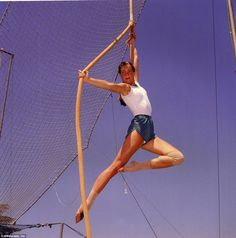High-flying fun: A then 15-year-old Brooke Shields poses while performing a trapeze act. The actress was training for a Circus of the Stars TV special in July 1980