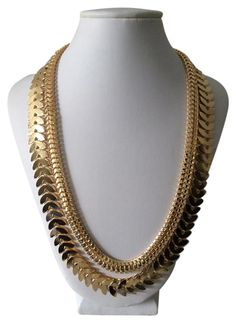 Gold Double chain necklace. Free shipping and guaranteed authenticity on Gold Double chain necklace at Tradesy. Gold Necklace featuring double chains.  The length...