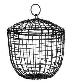 Black. Small wire basket in painted metal. Lid with metal ring at top. Diameter at top 7 3/4 in., height 8 1/4 in.