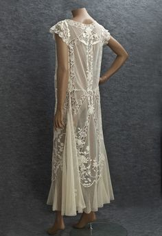 Kittyinva: 1922-24 c. hand embroidered and handmade lace on a ground of ivory-colored cotton tulle. An afternoon dress from Vintage Textile.