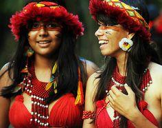 Brazilian Pataxo indians girls smile before the green games at the Kari-Oca indian village on June 14, 2012 as part of the UN Rio+20 environmental summit in Jacarepagua, Rio de Janeiro, Brazil.