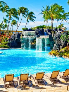 Swim under the waterfall to reach the water slide and whirlpool at Kona Pool at Hilton Waikoloa Village in Hawaii.