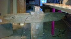 """Middle table leg - table legs are 10"""" x 10"""" heart-pine sills (foundation) that were 40 feet long."""
