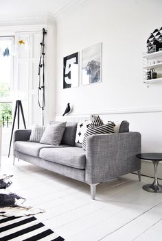 Living room. Sleek, clean, gray. Maybe a little less white but I like it. Gives it a vintage/modern feel...