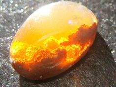 This is another kind of opal, called the Fire Opal. It's found in Mexico and inside seems to be filled with flames or a sunset. Opal is my birthstone. What a great stone to make a fun jewelery piece! Minerals And Gemstones, Rocks And Minerals, Rare Gemstones, Natural Gemstones, Sunset Fire Opal, Sunset Sky, Sunset Colors, Beautiful Rocks, Beautiful Sunset
