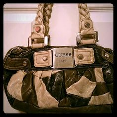 Vtg. 90'sGuess Leather Patchwork Purse Various greys and white are patchworked together with cream braided leather handles.  Some damage to handles, see pic 3. Zippered pocket on back  and one inside. Also,  3 regular inside pockets that have become slightly detached on one side.  Easy sew fix of an inch. Scratches on name brand plate. This bag has been well-loved,  but she had some years left in her! Guess Bags Satchels