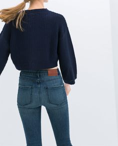 high waisted jeans and cropped sweater