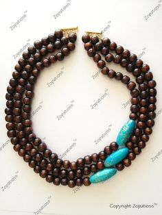 Nice DIY necklace! Usually not a fan of wooden beads, bud subbing in a deep brown stone bead would make the same impact.