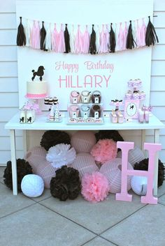 Pink and black dessert table at a modern 50's birthday party! See more party ideas at CatchMyParty.com!