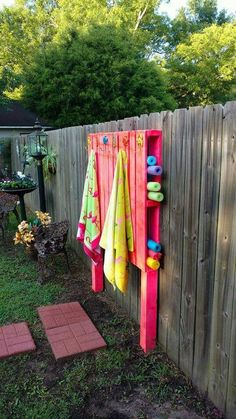 Clever pallet wall for towel and pool noodles storage