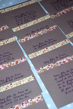 Decorate envelopes using Washi tape.
