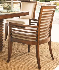 The Kowloon Arm Chair is designed with Bali sun-drenched sienna horizontal wood slats around the back and arms, with a cushioned seat and back. The Bimini Sand fabric will make a most welcome addition amongst any existing décor with its taupe and cream weave. Place at the head of the Peninsula Dining Table for a look that is comfortably elegant.