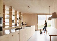 Strips of local spruce clad Haus Feurstein by Innauer‐Matt Architekten