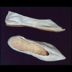 "Pale blue silk taffeta shoes, English, ca. 1810. Shoes are ""straights,"" with no difference between right or left last."