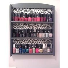Use old spice racks and scrapbook paper to make an easy nail polish shelf