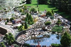 I want a train garden...someday when I'm a bazillionaire and can hire a gardener.