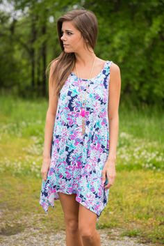 Breezy Palms Dress, Navy || We are so in love with this dress! The print is a summertime dream!! A mix of flowers and pineapples is the perfect pattern for a tropical vacation! Or making you wish you were on one! Paired with the super soft and stretchy fabric, you can't beat the style and comfort of this dress!