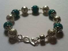 Sexual Violence Awareness Bracelet   A 7 1/2 inch bracelet made with silver filagree beads and end caps, teal stone beads, a silver awareness ribbon link and a magnetic clasp. $19.99