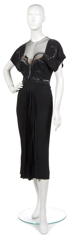 An Adrian Black Silk Evening Dress, 1940s,  with black feather motif beading at bodice, pleated insert at skirt. Labeled: Adrian Custom.