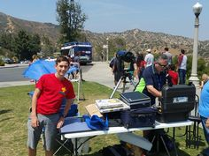 Zoly Dubrovics and son are setting up their gear for the public star party.