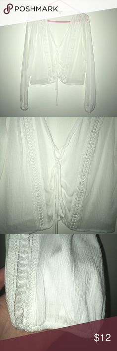 Charlotte Russe White Blouse Super pretty white blouse, lace detailing on the front and the sides of the sleeves, goes to right above my hips, size small, lace up ties in front, great condition. Charlotte Russe Tops Blouses