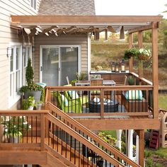 A canopy system and right-size furnishings turn this deck into an inviting hangout. Retractable shade panels on a sliding track are attached to the pergola and block the sun's rays. The panels' neutral taupe color makes them look like an extension of the home.