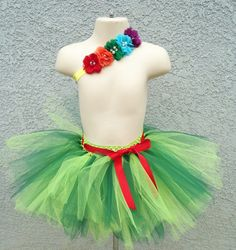 Dress up your little ones birthday in this Very Hungry Caterpillar themed tutu and headband. Tutu is made on a lime green crochet band with 2 layers