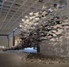 """""""Descent"""", Joyce Dallal hundreds of paper airplanes printed with the articles of the Geneva Conventions"""