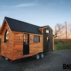 """Prepare to fall in love with the newest tiny house from French builder, Baluchon!  Named """"Calypso"""", the home has two loft bedrooms, a full kitchen, a dining table for three, a living room, bathroom, and plenty of storage space!  More details and photos are on the blog- link in profile! . . . #tinyhousemovement #tinyhome #tinyhomes #tinyhouse #tinyhouses #house #home #thow #design #french"""