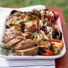 A light herb vinaigrette dressing is drizzled over the grilled eggplant and other vegetables in this low-calorie side dish.