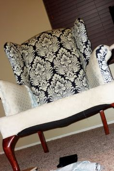 Love the two different fabrics! That's what I want to do with my chair!  Wonder where they found the fabric? I'm looking for a good on-line store that sells upholstery fabric.