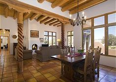 This beautifully decorated Santa Fe style home includes exposed vigas and carved beams Saltillo title floors, and two fireplaces. Enjoy the Navajo rugs and original Pueblo pottery, as well as Southwes...
