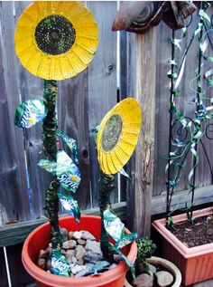 Sun Flowers from steamer baskets, petals from soda cans.