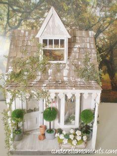 My Anthropologie inspired dollhouse is done. It was a lot of fun to make!    I found the topiary trees at Michaels craft store. They are...