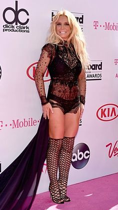 It's Britney! Britney Spears appears in a lacy body suit, thigh-high sandals and a long black train at the Billboard Music Awards 2016.