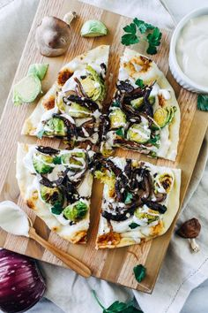 White Garlic Cashew Cream Pizza with Dijon Brussels and Shiitake Bacon- packed full of so much flavor, you won't miss the cheese in this amazing plant-based pizza!