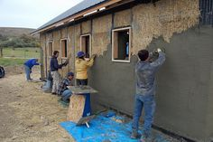 Ellensburg straw bale construction plastering workshop barn raising, group plastering north wall