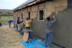 Ellensburg straw bale construction plastering workshop barn raising, group plastering north wall